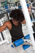 stock photo of weight-lifting  - Man at the gym lifting weight in a machine - JPG