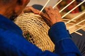 Old man Basket weaving from bamboo