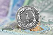 picture of zloty  - Polish coins stacked on a banknote. Polish Zloty .