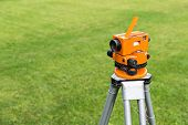 picture of theodolite  - Surveyor equipment optical level or theodolite outdoors at construction site