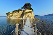 stock photo of cameos  - Old wooden bridge to Cameo island in Zakynthos island  - JPG