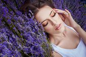 romantic portrait of beautiful woman on the lavender field