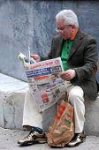 Old Man Reads Newspaper