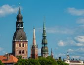 Towers of Riga seen in Riga. Three church towers in the picture are the Riga Dome cathedral,  St. Saviour's Church and St. Peter's church. On the right is Building of Academy of Sciences