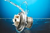 Auto Parts, Engine Cooling Pump In Water Splash On Blue Background