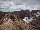 foto of gunung  - Hikers walking around the rim of Gunung Bromo volcano in East Java - JPG