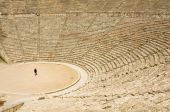 image of epidavros  - Tourist in ancient theater in Epidaurus Greece - JPG