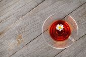 Herbal tea with chamomile flower on wooden table background
