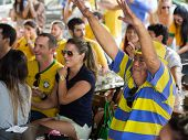 Cheerful Brazil Fans Watching World Cup Football Match at a Bar