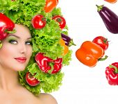 Beauty girl with Vegetables hair style. Beautiful happy young woman with vegetables on her head. Healthy food concept, diet, vegetarian food. Dieting concept. Weight loss. Vegan food. Healthy eating