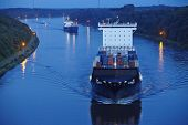 Beldorf - Container Vessel At Kiel Canal In The Evening