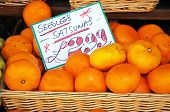 stock photo of satsuma  - Basket of seedless satsumas for sale outside a shop along High Street Broadway Cotswolds Worcestershire England UK Western Europe - JPG