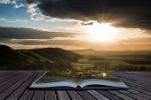 Stunning Summer Sunset Across Countryside Landscape With Dramatic Clouds Creative Concept