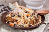 Plov, pilaf with rice, meat, raisins