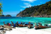 Lipe, Satun, Thailand - March 15, 2014: Fisherman Sailed Longtail Boat To Visit Beautiful Beach Of K