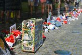 WASHINGTON, D.C. - MAY 26, 2014: People visit and lay flowers and other souvenirs  at the Vietnam Ve