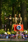 WASHINGTON, D.C. - MAY 26, 2014: People visit and lay flowers at the Vietnam Veterans Memorial durin