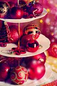Christmas decorations on dessert stand, on color background