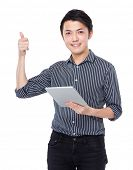 Asian Businessman use of tablet and thumb up