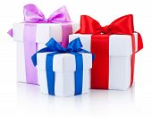 Three White Boxs Tied With Colored Satin Ribbons Bow Isolated On White Background