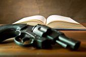 Open Book With Handgun