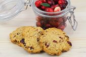 Crunchy cookies with cranberries and jar of fresh cranberries
