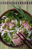 Vietnamese Pho Bo Soup With Beef Rare Closeup. Top View