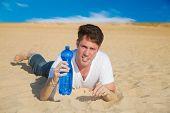 Caucasian Man With Water In Desert