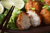 Traditional Asian Fish Balls With Lime And Salad Macro