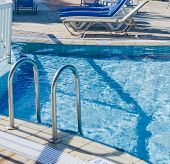 A Swimming Pool With Sun Loungers