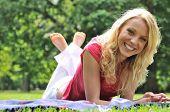 Young Beautiful Woman Lying Outdoors