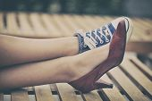 pic of legs feet  - Woman resting on chair - JPG