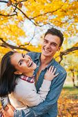 Portrait Of Happy Young Couple Outdoors In Park In Autumn Having
