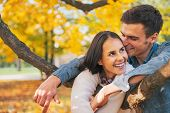 Portrait Of Smiling Young Couple Outdoors In Autumn Having Fun T