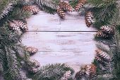 foto of snow border  - White shabby Christmas border with snow covered pinecones - JPG