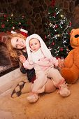 stock photo of rabbit year  - Mother with son in a rabbit costume - JPG