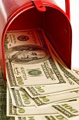 Money Flowing From Red Mailbox
