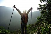 pic of open arms  - cheering woman hiker open arms at mountain peak - JPG