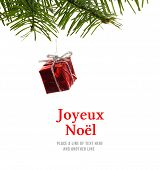 Joyeux noel against red christmas decoration hanging from branch