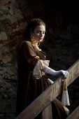 image of 1700s  - a Renesaince style girl in old town - JPG