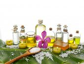 spa supplies with orchid, oil, yellow candle ,soap ,salt on banana leaf