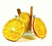slices of orange with cinnamon