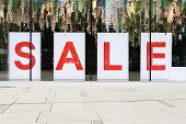 sale poster in the fashion shopfront