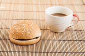 Hamburgers And Cup Of Black Coffee On Wooden Board.