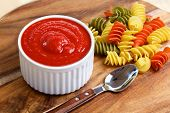 Tomato sauce with italian pasta and spoon
