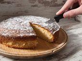 Cutting A Piece Of Sponge Cake