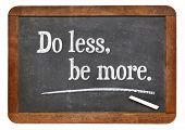 Do lees, be more - motivational advice on a vintage slate blackboard