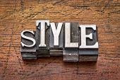 style word in mixed vintage metal type printing blocks over grunge wood