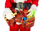 Santa Worker with a tool belt over white background.