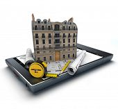 Handheld device with a classic building and blueprints on top